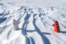 Free Two Little Lonely White And Red People Stay On Snow Royalty Free Stock Images - 29881599