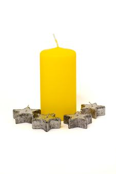Free Yellow Candle And Four Silver Candles Royalty Free Stock Photography - 2990907
