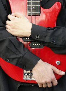 Free Man Embracing Bass Guitar Stock Photos - 2993993