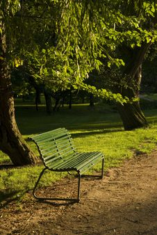 Bench In Sunset By Path Royalty Free Stock Photo