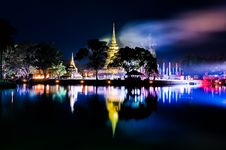 Free Buddhist Colorful Temple At Night With Lake Reflection Stock Photo - 29901360