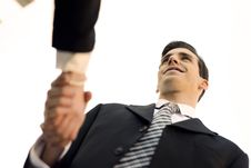 Businessman And Businesswoman Shaking Hands Outside Of Office Bu Royalty Free Stock Images