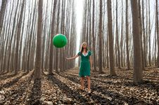Free Beautiful Blonde Girl, Dressed In Green, Walking Into The Forest Royalty Free Stock Photography - 29904067