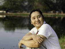 Happy Asian Woman In The Park Royalty Free Stock Image