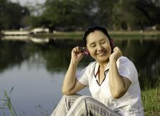 Free Beautiful Asian Woman Listening Music In Headphones With Closed Royalty Free Stock Images - 29906099