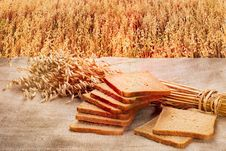 Free Loaf Of Rye Bread On A Background Of Ripe Rye Field At Sunset Royalty Free Stock Image - 29906546