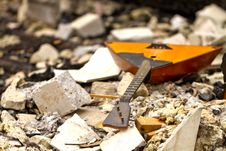 Free Balalaika On The Ruins Of A Destroyed House Royalty Free Stock Photos - 29917998