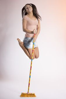 Happy Woman Jumping High Holding To A Broom Stock Images