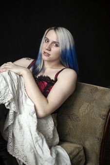 Beautiful Young Goth Woman With Blue Hair And Red Corset Royalty Free Stock Photos