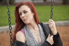 Free Young Woman With Beautiful Auburn Hair On A Swing Royalty Free Stock Image - 29945116
