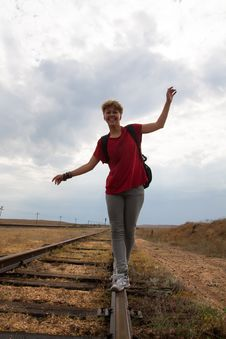 Free Smiling Teen Girl Walking On Rail Road Stock Images - 29947324