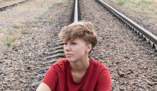 Free Sad Teen Girl Sitting On Rail Road Royalty Free Stock Photos - 29947378