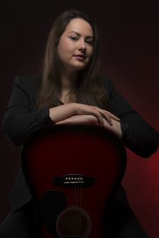 Young Beauty With Guitar Portrait Stock Image