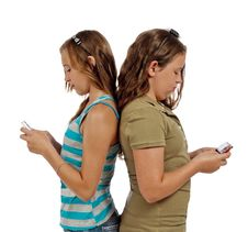 Free Teenage Girls Text Messaging Instead Of Talking Stock Photography - 29952092