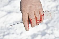 Bloody Hand Holding Syringes Stock Image