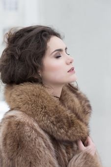 Love. Affectionate Dreamy Sensual Woman In Fur Coat In Reverie. Serene Stock Photos
