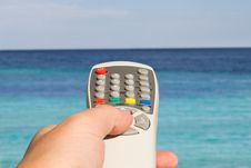 Somebody Hand Pointing Remote Control Towards The Sea Stock Images