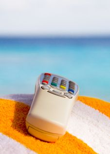 Free Remote Control With A Sea Background Royalty Free Stock Photos - 29975058