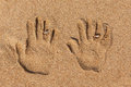 Free Hand Prints On The Sand. Stock Photos - 29982523