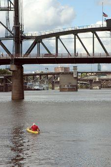 Free Man Kayaking Under Bridges Royalty Free Stock Photography - 39397