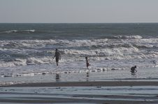 Family Playing In The Surf Royalty Free Stock Image