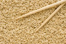 Brown Rice And Chopsticks Stock Images