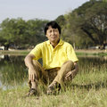 Free Asian Middle-aged Man In The Park Stock Image - 30007141