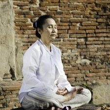 Free Woman Meditating Against Ancient Temple Stock Photography - 30007182
