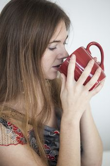 Free Young Woman With Beautiful Green Eyes With Red Coffee Cup Royalty Free Stock Photo - 30023295