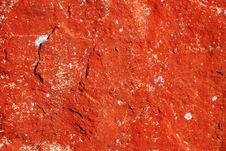 Red Background Of The Mossy Stone Surface Stock Photos