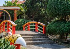 Free Chinese Garden With Red Bridge Stock Photo - 30030920