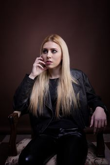 Free Gorgeous Caucasian Girl Sitting On A Vintage Chair In Leather Ja Royalty Free Stock Photos - 30035958