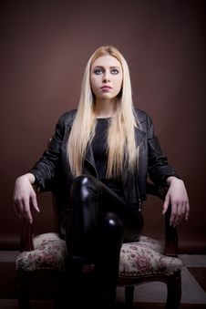 Free Beautiful Girl In Leather Jacket On A Vintage Chair Looking Up Royalty Free Stock Images - 30035999