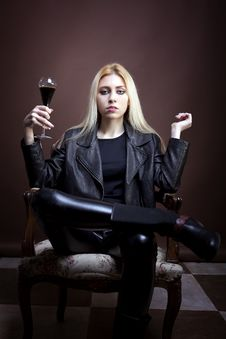 Free Rock Girl Holding A Glass With Dark Liquid Stock Photo - 30036100