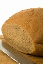 Free A Bread With Knife On Cutting Board Stock Images - 30049254
