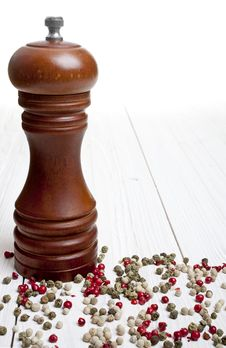 Pepper-mill With Peppercorns On White Background Stock Photography