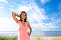 Free Girl In Pink Dress On Seacoast Royalty Free Stock Images - 30066769
