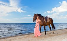 Girl In Dress With Horse On Seacoast Royalty Free Stock Photo