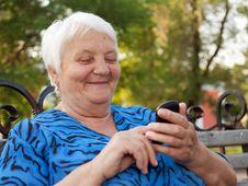 Senior Woman And New Technologies Royalty Free Stock Photos