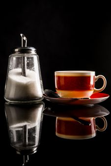 Free Sugar-basin And A Cup Of Tea On Reflecting Surface Royalty Free Stock Photo - 30082765