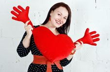 Woman With Red Heart Toy Royalty Free Stock Photography