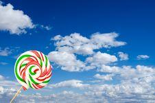 Free Single Sugar Lollipop In White Green And Red On Background Of Sk Royalty Free Stock Photos - 30087628