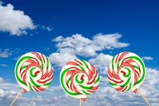 Free Three Sugar Lollipops In White Green And Red On Background Of Sk Stock Images - 30087634