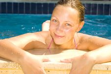 Girl Relaxing At The Pool Stock Image