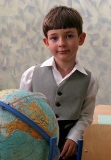 Schoolboy And Globe Royalty Free Stock Photography