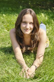 Free Young Girl Lying On The Grass Stock Photography - 3013472