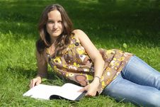 Free Girl Lying On Grass With Book Stock Photos - 3013473