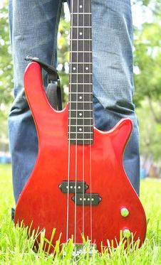 Free Red Bass Guitar On The Grass Stock Images - 3013474