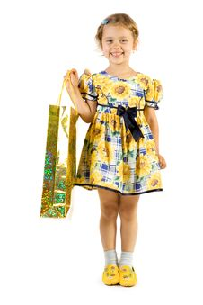 Little Smiling Girl With Shopping Bag Royalty Free Stock Photography