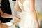 Free Bridesmaid Helping Bride To Dress Royalty Free Stock Photos - 30111618